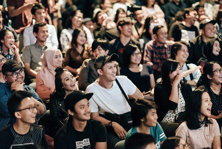Enjoying the show: The audience reacts to Gerald Situmorang's performance at German cultural center GoetheHaus in Central Jakarta.