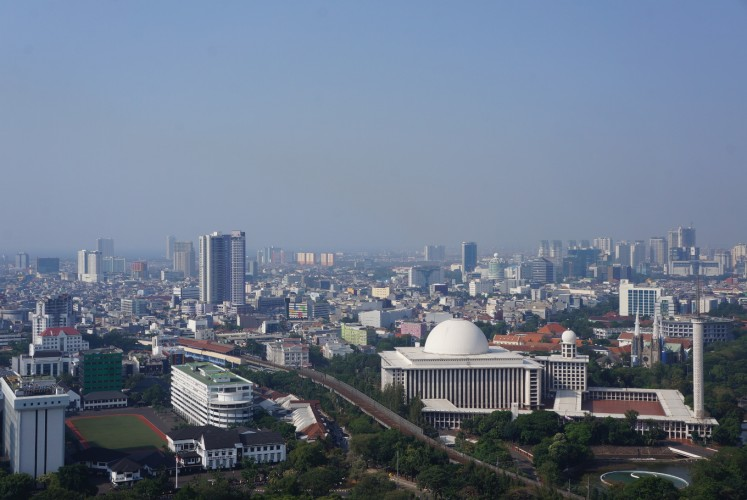 Istiqlal Mosque (right) viewed from the peak of the National Monument (Monas) on Thursday, September 14, 2017.