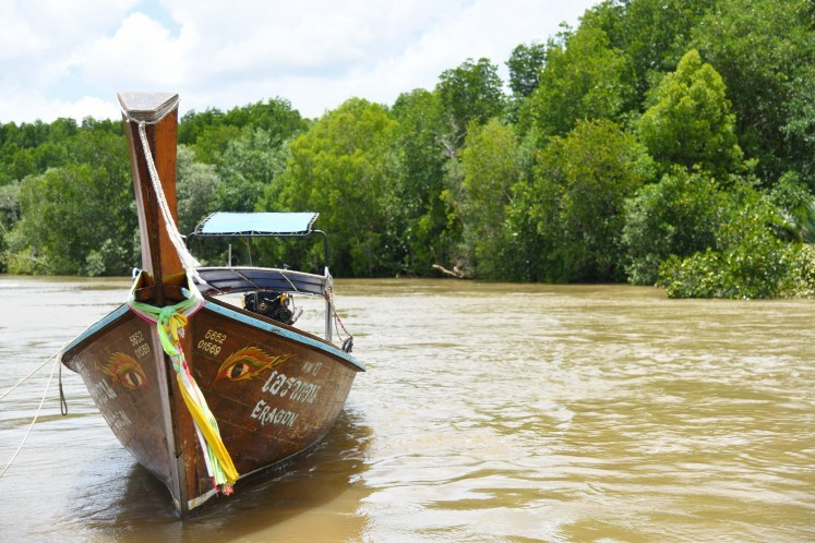 To reach Koh Klang, tourists need to ride a 'hua tong' (traditional long-tail boat).