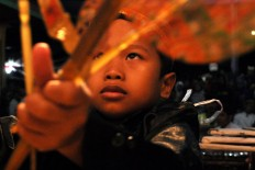 A young puppeteer performs during the Mount Merapi offering ritual. JP/Magnus Hendratmo