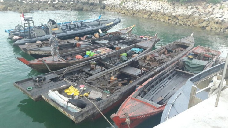 The wooden boats allegedly used by the pirate suspects who were arrested by the Indonesian Navy's Western Fleet Quick Response Unit (WFQR) in Singapore straits on Sunday.