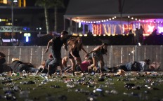 People run from the Route 91 Harvest country music festival after apparent gun fire was heard on October 1, 2017 in Las Vegas, Nevada. There are reports of an active shooter around the Mandalay Bay Resort and Casino.  AFP/Getty Images/David Becker