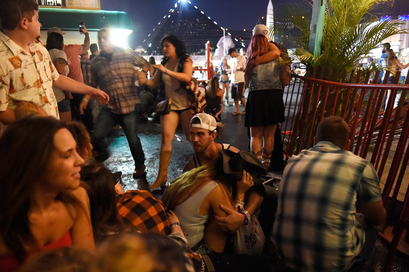 People run for cover at the Route 91 Harvest country music festival after apparent gun fire was heard on October 1, 2017 in Las Vegas, Nevada. There are reports of an active shooter around the Mandalay Bay Resort and Casino. AFP/Getty Images/David Becker