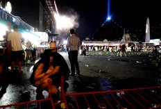 People take cover at the Route 91 Harvest country music festival after apparent gun fire was heard on October 1, 2017 in Las Vegas, Nevada. There are reports of an active shooter around the Mandalay Bay Resort and Casino.  AFP/Getty Images/David Becker