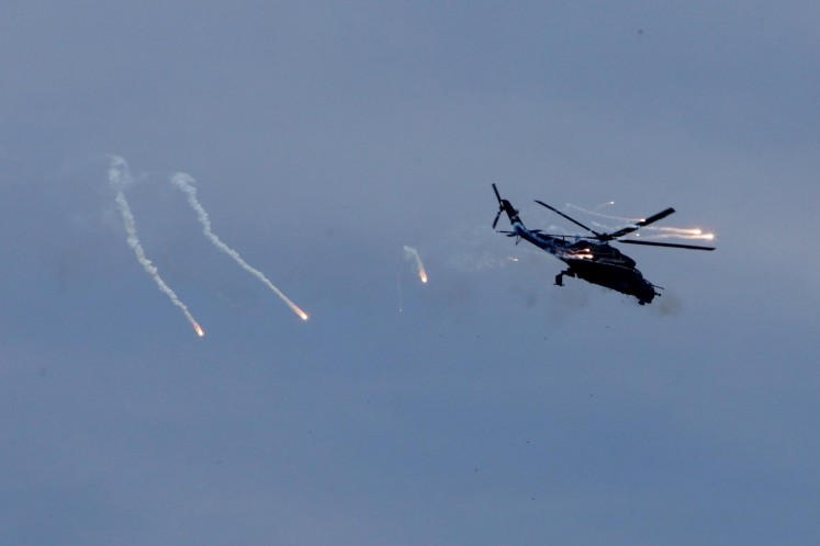 An Mi-35P attack helicopter performs a drill during the commemoration of the 72nd anniversary of the Indonesian Military (TNI) in Cilegon, Banten, on Oct. 5.