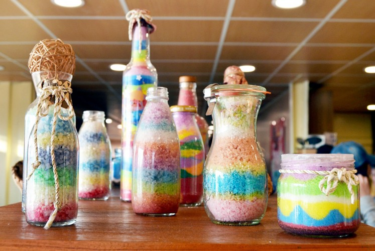 Bottled rainbow: Colorful salt products from Jingzaijiao Tile-paved Salt Fields.