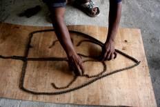 Agung assembles the basic design of Gunungan (shadow puppet conical), which symbolizes human life. JP/Maksum Nur Fauzan
