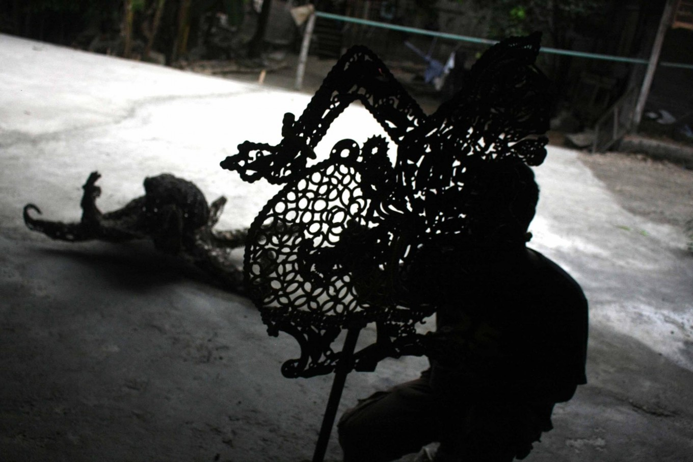 The silhouette of a craftman completing the puppets making. JP/Maksum Nur Fauzan