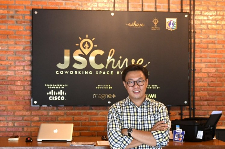 This picture taken on Sept. 12, 2017 shows Willson Cuaca, one of the co-owners of the EV-Hive event space, a co-working space, in Jakarta. Big-name investors including Expedia and Alibaba are pumping billions of dollars into Indonesian tech start-ups in a bid to capitalise on the country's burgeoning digital economy and potential as Southeast Asia's largest online market. Indonesia has seen a surge of cash into its technology sector over the past two years, helping support dozens of homegrown start-ups ranging from ride hailing apps to e-commerce firms.