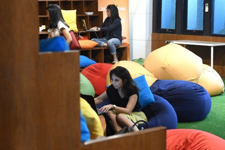 This picture taken on Sept. 12, 2017 shows entrepreneurs working at the EV-Hive event space, a co-working space, in Jakarta. Big-name investors including Expedia and Alibaba are pumping billions of dollars into Indonesian tech start-ups in a bid to capitalise on the country's burgeoning digital economy and potential as Southeast Asia's largest online market. Indonesia has seen a surge of cash into its technology sector over the past two years, helping support dozens of homegrown start-ups ranging from ride hailing apps to e-commerce firms.