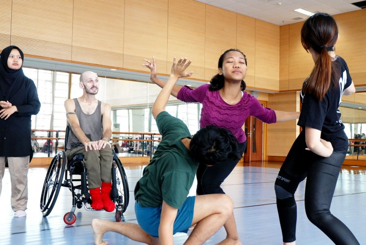 Express yourself: Brew gives dance lessons to his students.