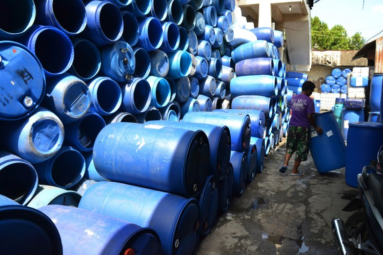 Used plastic barrels, collected from factories across Surakarta, await their turn to be transformed into a new, useful product.