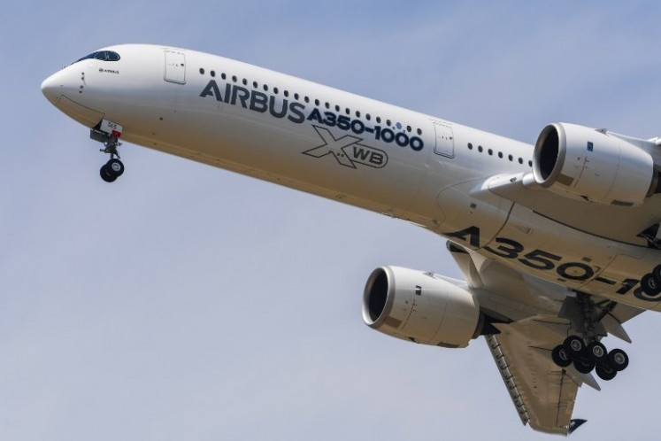 An Airbus A350-1000 XWB jet airliner performs its show flight during the International Paris Air Show at Le Bourget, north of Paris, on June 20, 2017.