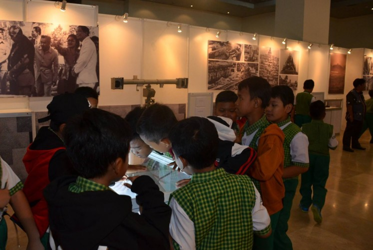 Students marvel at one of the documents displayed in the exhibition.