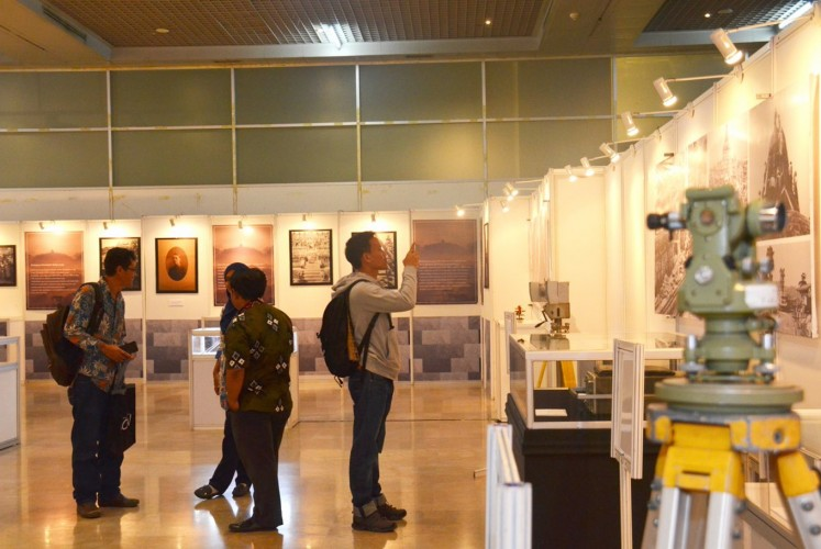 One visitor takes a photo of one of the exhibition's collections.