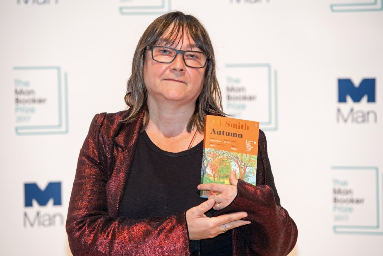 British author Ali Smith holds her book 'Autumn' during a photocall at the Royal Festival Hall in London on October 16, 2017, ahead of tomorrow's announcement of the winner of the 2017 Man Booker Prize for Fiction.