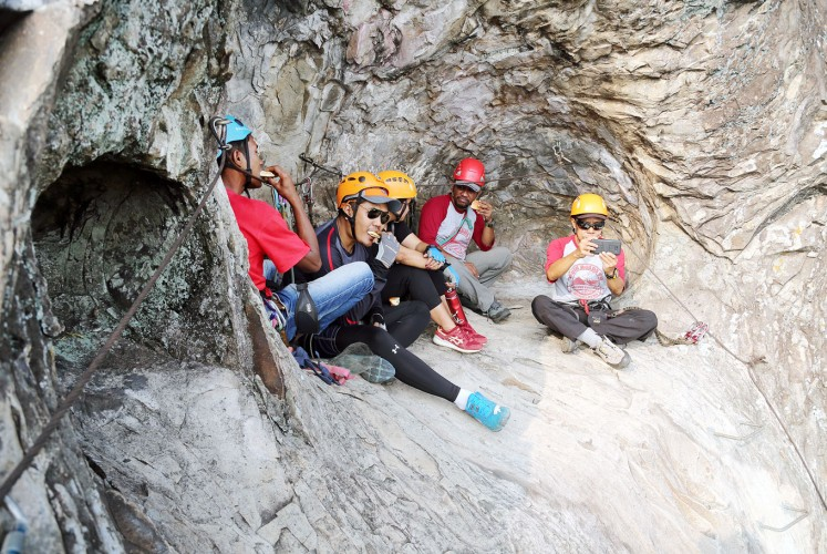 Rest and relax: Ogun and his fellow climbers take a break during a climb.