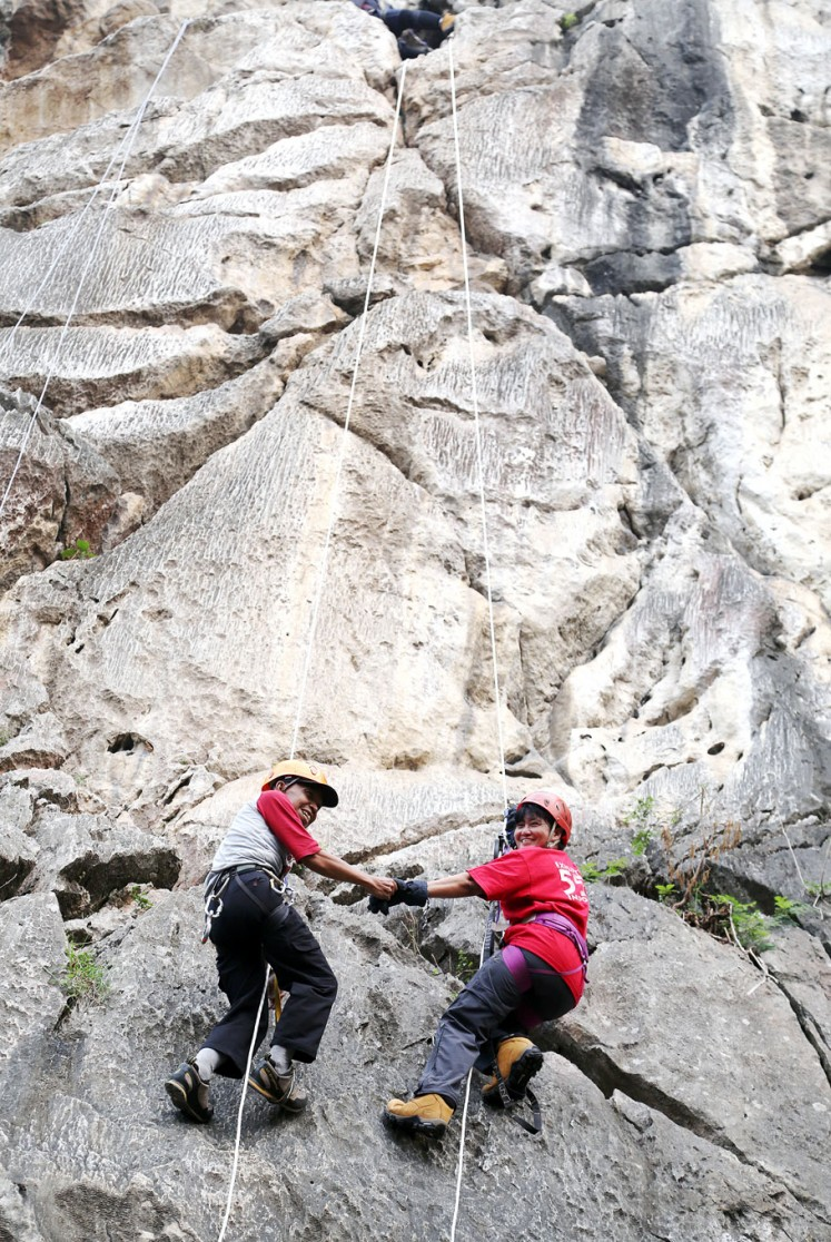 Always together: Ogun and his wife, Cecilia Yashita, hold hands during a climb.