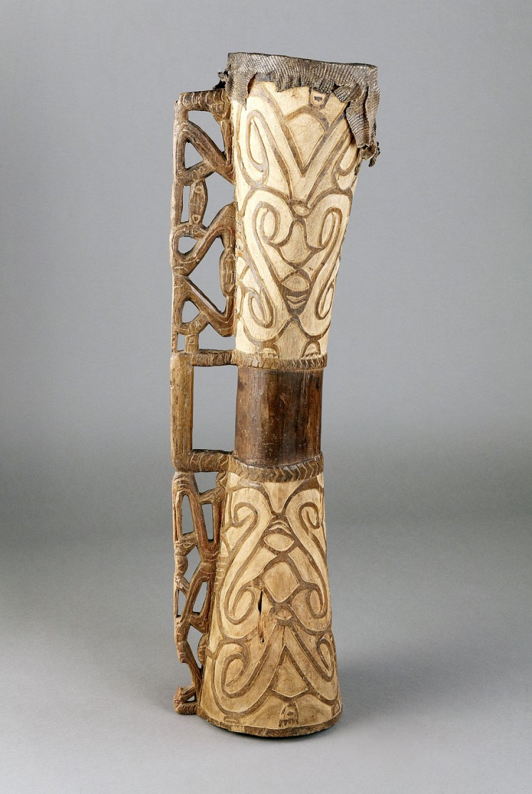 Exotic: Tambur percussion instrument made of wood and reptile skin.