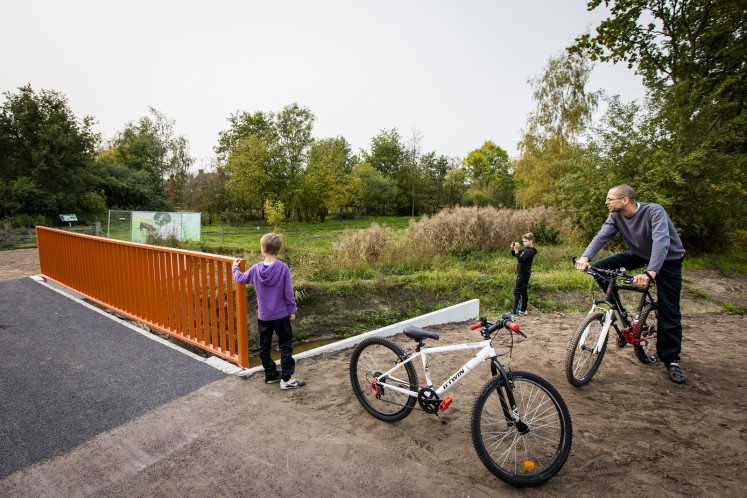 Dutch officials toasted the opening of what is being dubbed as the world's first 3D-printed concrete bridge, which is primarily meant to be used by cyclists.