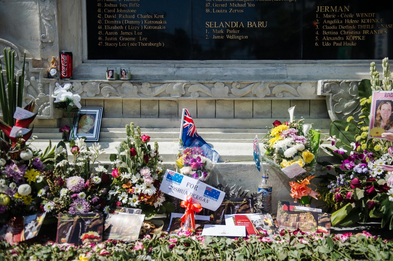 Flowers, letters, photographs and incense are laid at the monument to honor the Bali bombing victims. JP/Anggara Mahendra