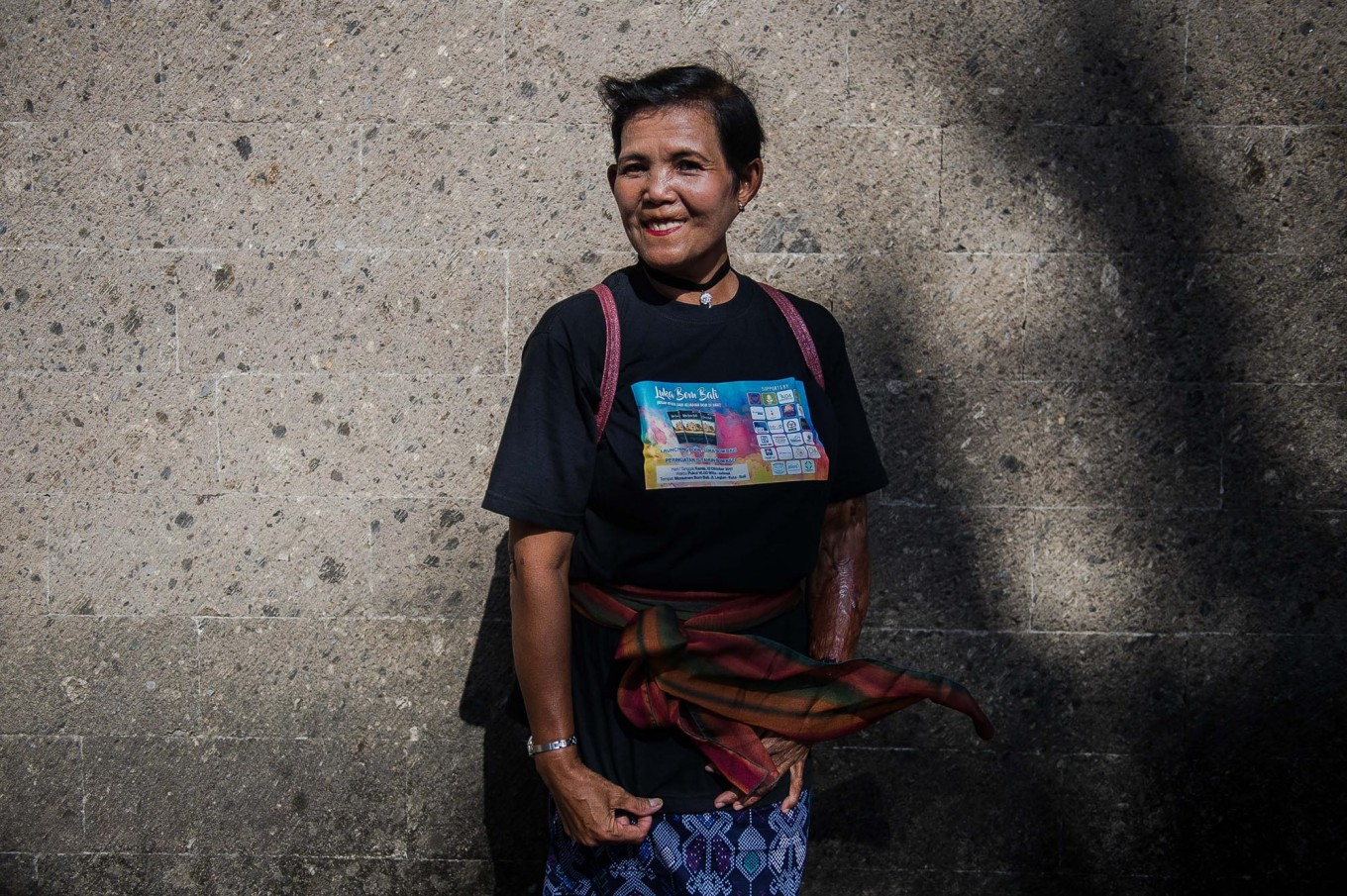 Ngesti Puji Rahayu, one of the 2002 bombing survivors, poses for a photo. She suffered burns on her left arm. JP/Anggara Mahendra