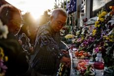 A Japanese family of Bali bombing victims pays respect at Ground Zero. JP/Anggara Mahendra