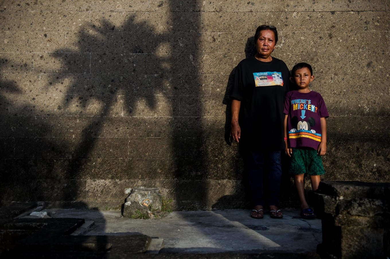 Chusnul and his son, Muafa, pose during the 15th anniversary of the Bali bombings at Ground Zero. JP/Anggara Mahendra