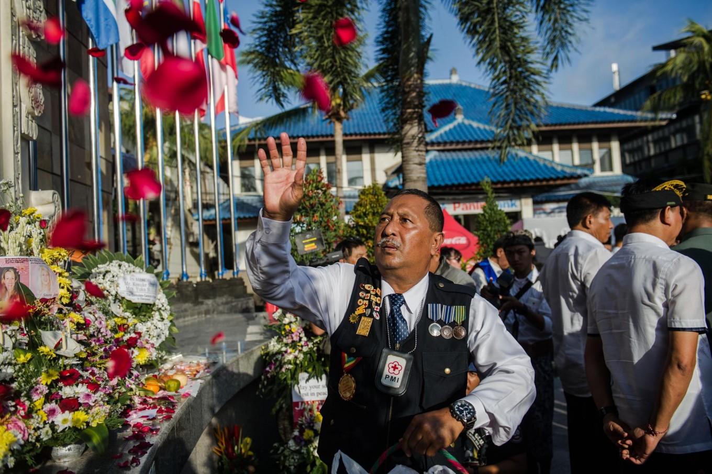 Agus Bambang Priyanto throws red rose petals at the Ground Zero Monument during a commemoration of the 15th anniversary of the Bali bombings. JP/Anggara Mahendra