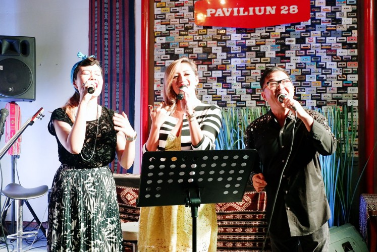For good cause: Singaporean composer Clement Chow (right) joins in the show, singing 'Brighter Days' during the album launch in Jakarta.