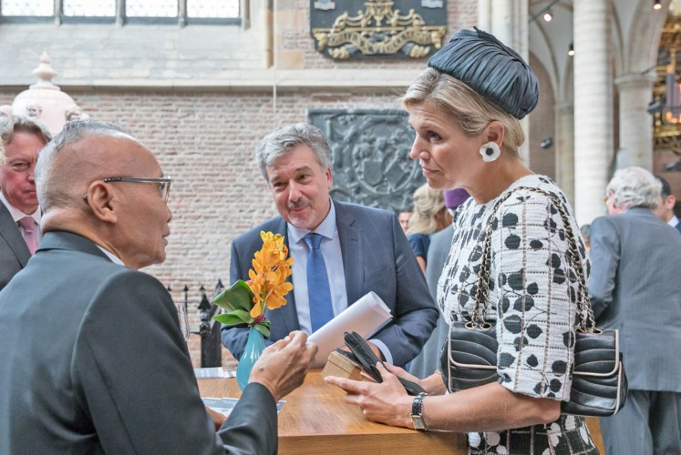 Book talk: Queen Máxima of the Netherlands (right) converses with former Indonesian education minister Wardiman Djojonegoro (left) after the Asian Library opening ceremony at the St. Pieters church in Leiden. Between them is Leiden University chief librarian Kurt de Belder.