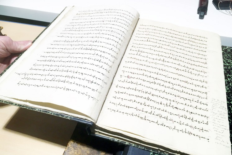 Treasured: A look into the pages of La Galigo, one of Asian Library's most treasured items. The text is written in old Buginese script.