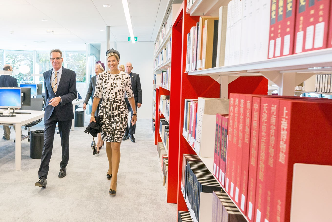 Royal inspection: Queen Máxima of the Netherlands (right) walks through the Asian Library, accompanied by KITLV head Geert Oostindie. (Leiden University/Monique Shaw)