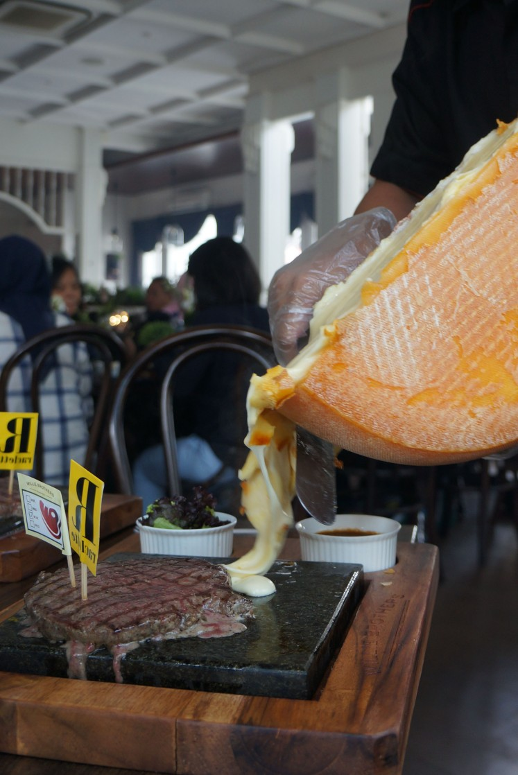 The steak is specifically seasoned to match raclette cheese's intense flavor.
