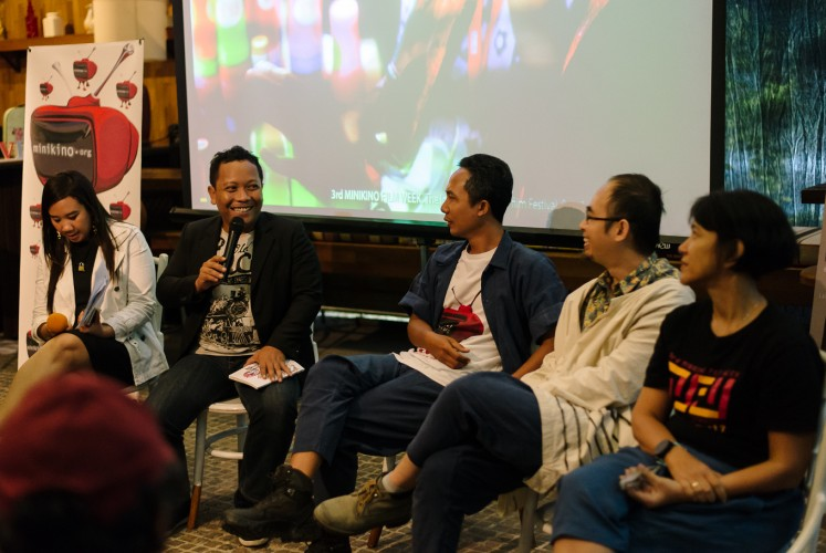 (From second left to right) one of the judges of the third Minikino Film Week Daniel Rudi Haryanto, the festival's executive director I Made Suarbawa, the festival director Edo Wulia and advisory board member Ursula Tumiwa at a press conference promoting the road show in Jakarta on Monday, Oct. 23, 2017..