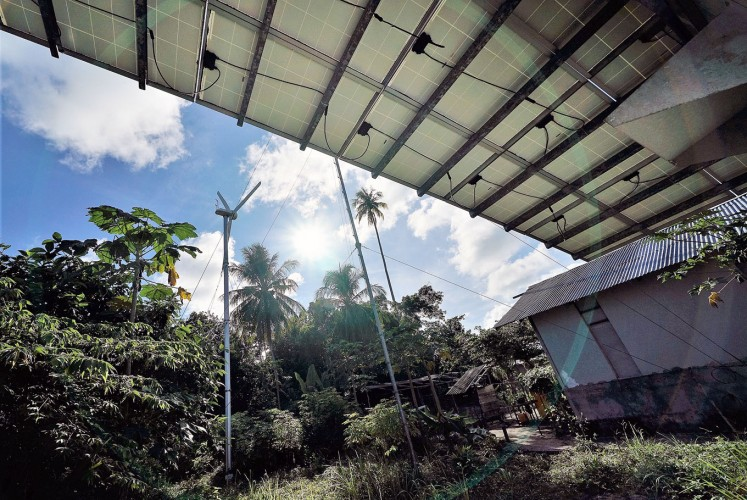 Dynamic duo: Residents on Maratua use the combination of solar energy and a windmill to generate electricity.