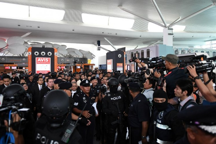 High Court judge Azmi Ariffin (unseen) lawyers for Vietnamese and Indonesian defendant arrive at the low-cost carrier Kuala Lumpur International Airport 2 ( KLIA2 ) during a visit to the scene of the murder as part of the Shah Alam High Court trial process in Sepang on Oct. 24, 2017. Indonesian Siti Aisyah, 25, and Huong, 28, have been charged with the murder of Kim Jong-Nam, the estranged half-brother of North Korean leader Kim Jong-Un, at Kuala Lumpur International Airport 2 ( KLIA2 ) in February.