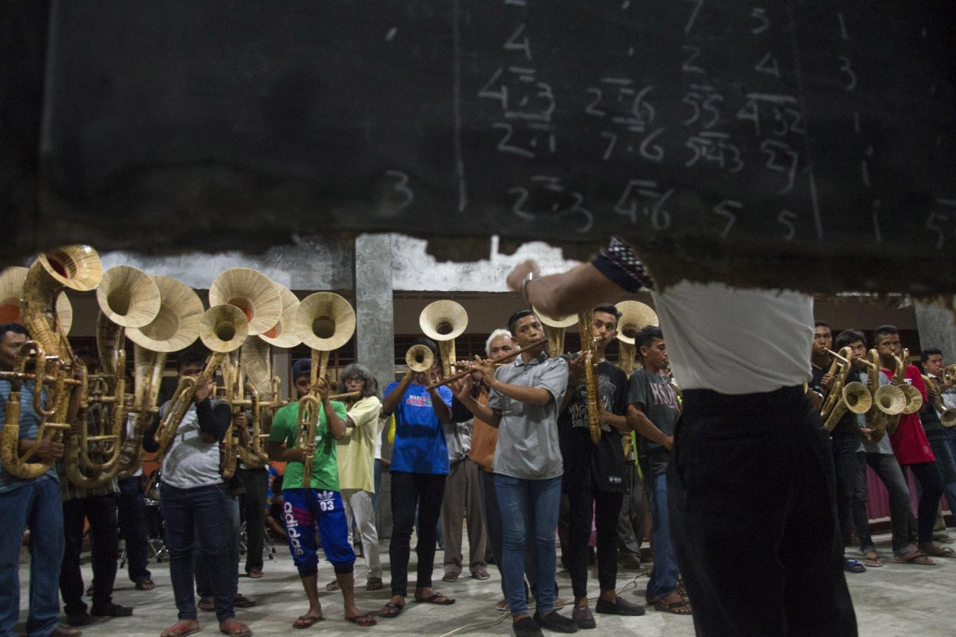 High and low: The music troupe in Sangihe, North Sulawesi, practices using a humble blackboard on which is written the musical score. JP/ Tarko Sudiarno