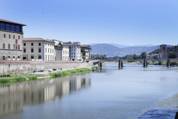 Serenity: The Ponte Vecchio, an arch bridge in Florence, Italy, stretches across the Arno River.