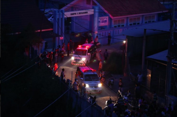 Ambulances on Thursday evening come for victims of the blaze that killed 47 people and injured 46 others at the fireworks factory in Kosambi, Tangerang.