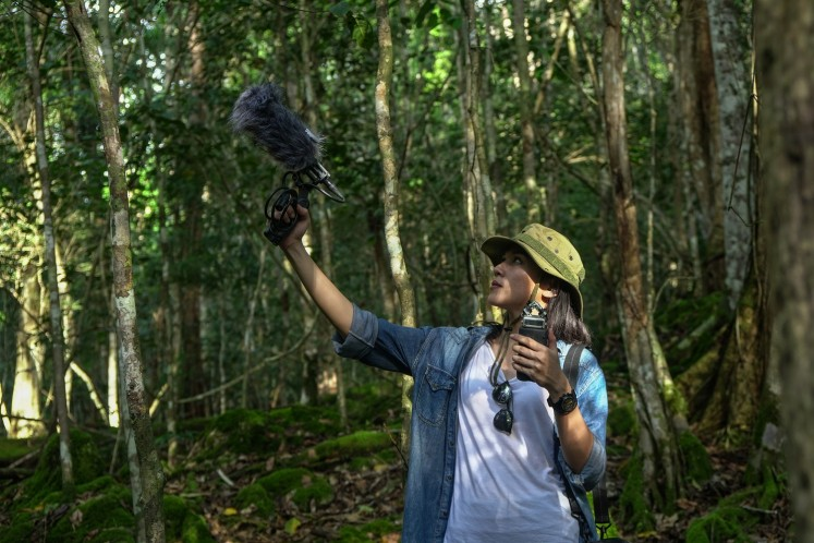 Ninda Felina records rainforest sounds that surround Malagufuk village.