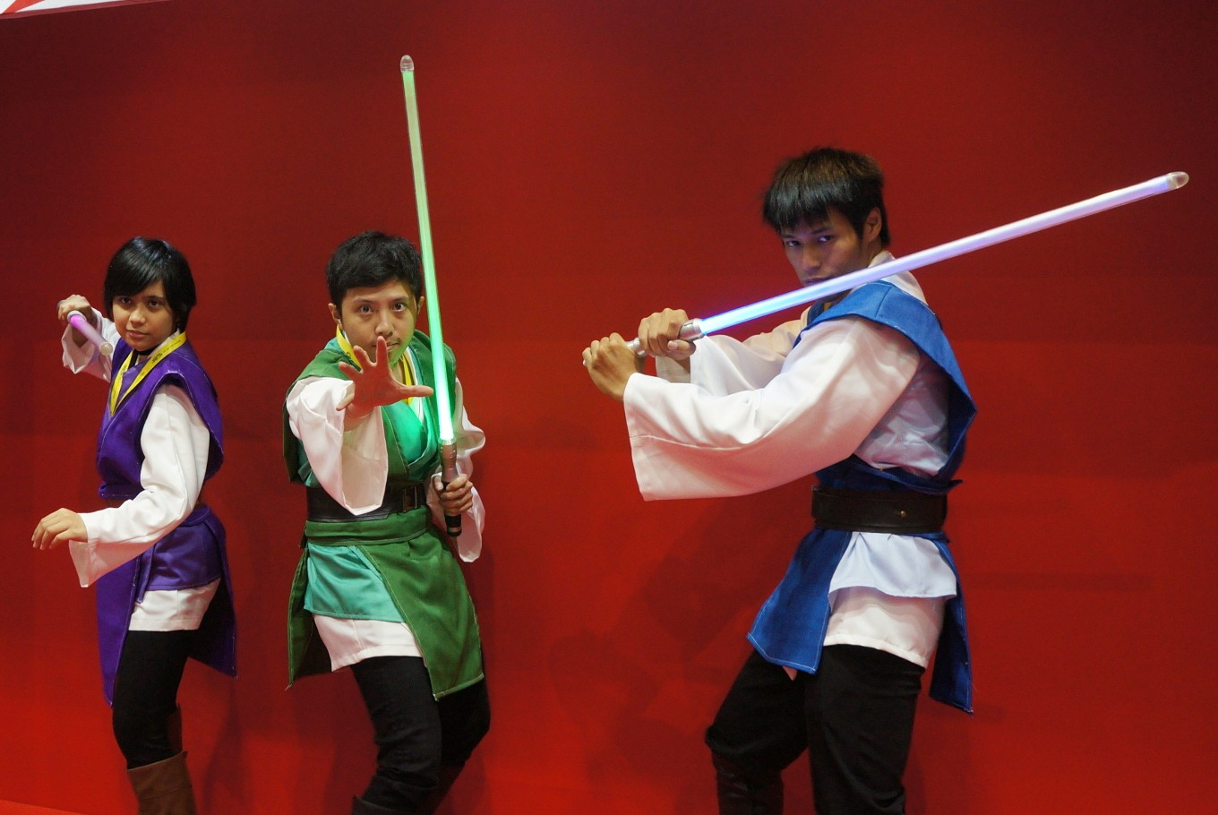Members of Fightsaber Indonesia strike a pose with their lightsabers during the 2017 Indonesia Comic Con.
