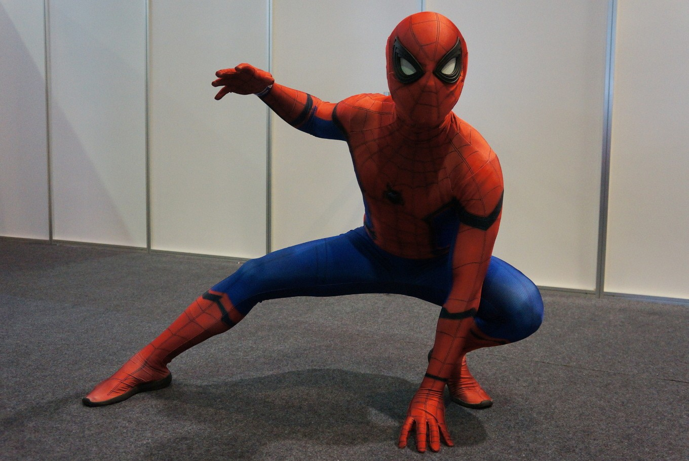 A cosplayer crouches as Spider-Man during  the 2017 Indonesia Comic Con.