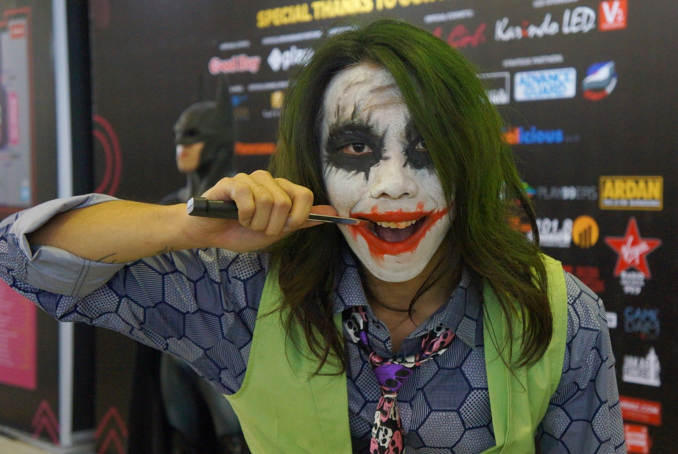 A cosplayer is dressed as Batman's ultimate nemesis, the Joker.