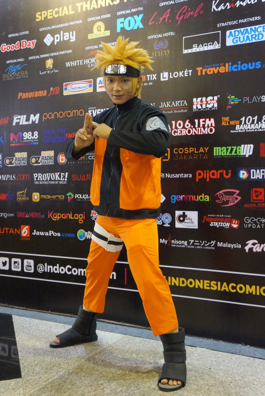 A man dressed as Naruto from 'Naruto Shippuden' strikes a pose during the 2017 Indonesia Comic Con.