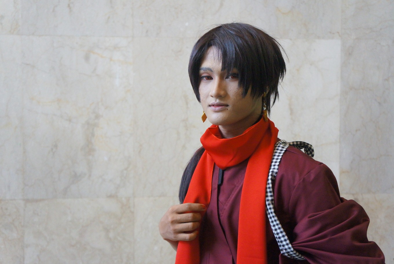 A cosplayer poses as Kashuu Kiyomitsu, a character from the video game 'Touken Ranbu.'