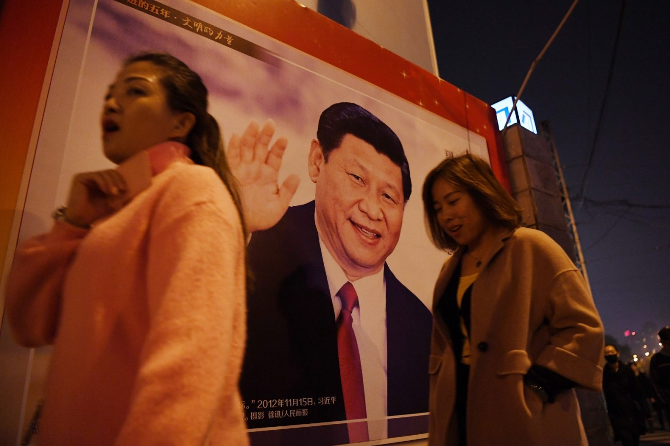 Chinese woman 'detained' after tossing ink on Xi poster: activists