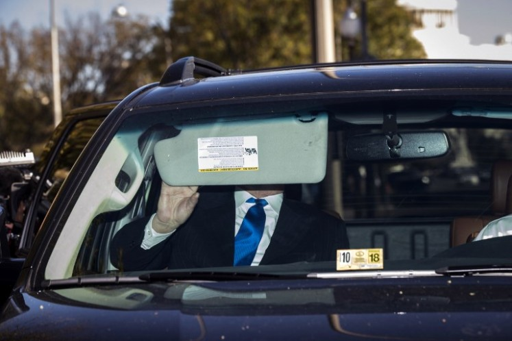 Former Trump campaign chairman Paul Manafort gets into his car after leaving federal court, Oct. 30, 2017 in Washington, DC. Paul Manafort and Rick Gates, have been indicted by a federal grand jury in the investigation into Russian meddling in the U.S. election.