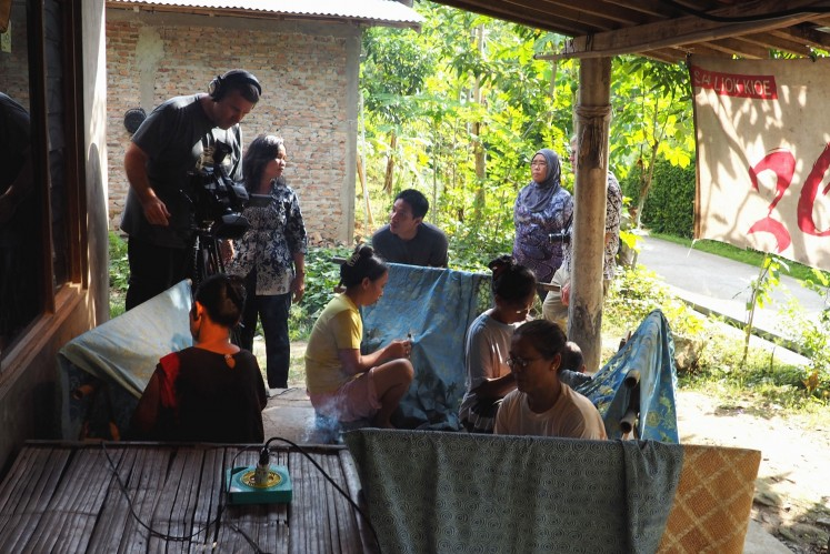 Andrew Galli traveled to Indonesia to meet batik-making communities.