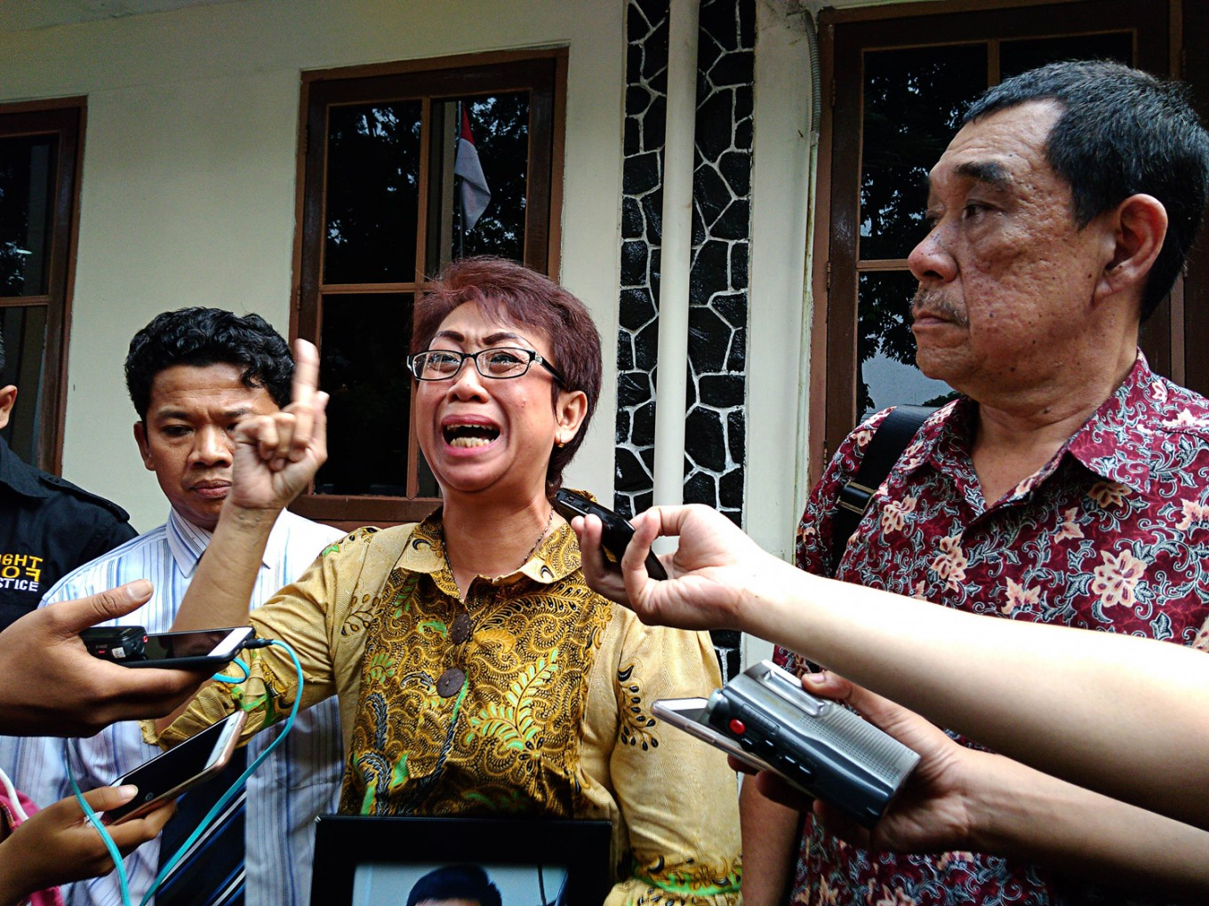 Parents decry light sentence given to son's killers